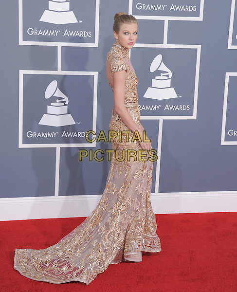 Taylor Swift (wearing Zuhair Murad).The 54th Annual GRAMMY Awards held at the Staples Center, Los Angeles, California, USA..February 12th, 2012.full length beige gold beads beaded dress side train .CAP/RKE/DVS.©DVS/RockinExposures/Capital Pictures.