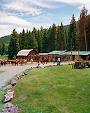 USA, Montana, stable and horses with cowboy and cowgirls, Mountain Sky Guest Ranch