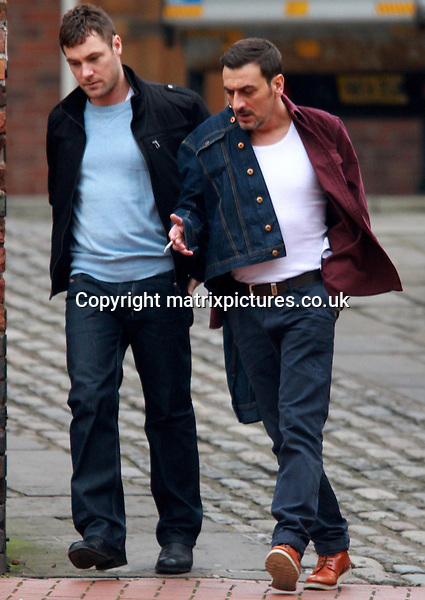NON EXCLUSIVE PICTURE: MATRIXPICTURES.CO.UK.PLEASE CREDIT ALL USES..WORLD RIGHTS..British actors Chris Gascoyne and Marc Baylis are pictured on the Coronation Street set in Manchester...The Coronation Street stars are on set to film the funeral of the character Sunita Alahan, played by British actress Shobna Gulati...MARCH 7th 2013..REF: IRF 131509