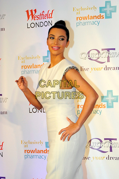Kim Kardashian .celebrates the launch of her weight management product, QuickTrim at Westfield, Shepherds Bush, London, England, UK, May 19, 2012,.photocall half length white dress hand on hip hair up bun top knot side .CAP/CJ.©Chris Joseph/Capital Pictures.