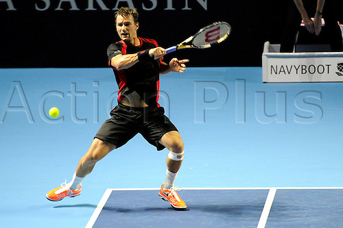 25.10.2016.  St. Jakobshalle, Basel, Switzerland. Basel Swiss Indoors Tennis Championships. Day 2. Marco Chiudinelli of Switzerland in action in the match with Stan Wawrinka of Switzerland