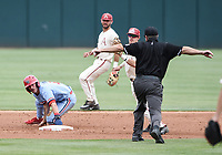 NWA Democrat-Gazette/CHARLIE KAIJO Arkansas Razorbacks infielder Casey Martin (15) attempts to tag Ole Miss infielder Anthony Servideo (3) during game two of the College Baseball Super Regional, Sunday, June 9, 2019 at Baum-Walker Stadium in Fayetteville. Ole Miss forces a game three with a 13-5 win over the Razorbacks