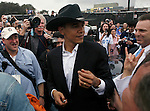 Sen. Barrack Obama wears a cowboy hat from a fan after speaking  to a crowd of supporters during a rally held in Austin, Texas on February 23, 2007.