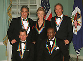 2000 Kennedy Center Honorees pose for a group photo after a State Department dinner in Washington, D.C. on December 2, 2000. Top, from left to right, singer Placido Domingo, actress Angela Lansbury, actor Clint Eastwood. Bottom, from left to right: dancer Mikhail Baryshnikov, and musician Chuck Berry..Credit: Robert Trippett - Pool via CNP