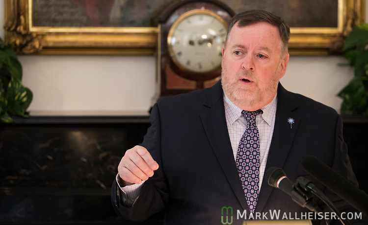 "Mike Carroll, Secretary of Department of Children and Families, speaks during a press conference to launch Prevent Child Abuse with Florida's annual ""Pinwheels for Prevention"" campaign at the Florida Governor's Mansion."