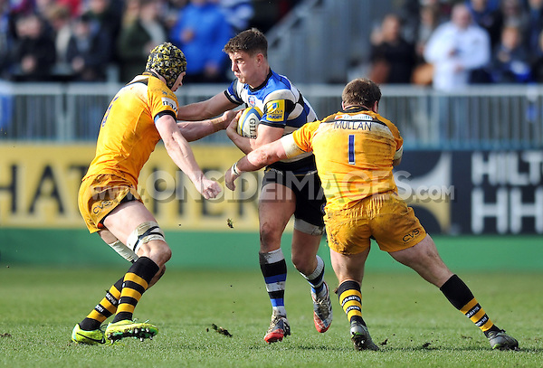 Ollie Devoto takes on the London Wasps defence. Aviva Premiership match, between Bath Rugby and London Wasps on February 22, 2014 at the Recreation Ground in Bath, England. Photo by: Patrick Khachfe / Onside Images