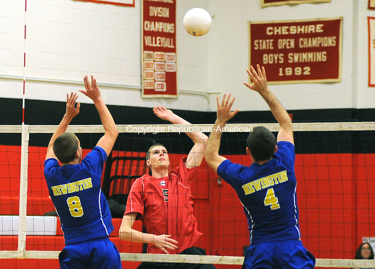 CHESHIRE,  CT, 02 MAY 2012-050212JS15- Cheshire's Nathan Howard (5) goes up for the ball as Newington's Taylor Gallicchio (8) and Jorge Premto (4) go up for the block during their match  Wednesday at Cheshire High School. .Jim Shannon Republican-American