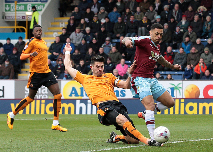 Burnley's Andre Gray is tackled by Wolverhampton Wanderers' Danny Batth<br /> <br /> Photographer David Shipman/CameraSport<br /> <br /> Football - The Football League Sky Bet Championship - Burnley v Wolverhampton Wanderers - Saturday 19th March 2016 - Turf Moor - Burnley<br /> <br /> &copy; CameraSport - 43 Linden Ave. Countesthorpe. Leicester. England. LE8 5PG - Tel: +44 (0) 116 277 4147 - admin@camerasport.com - www.camerasport.com