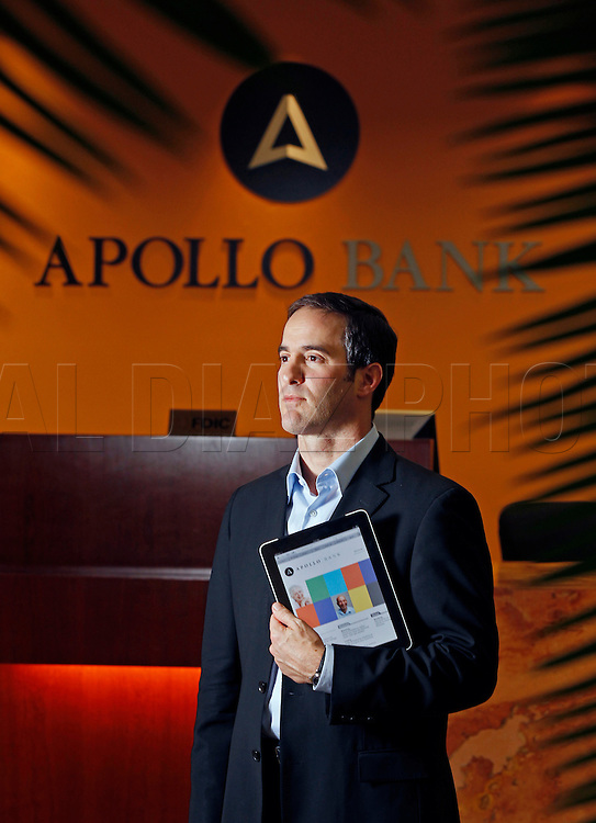 Chairman of the Board Eddy Arriola in the lobby of Apollo Bank in Miami on Friday, January 6, 2012.  Apollo bank hopes to buck the trend by adding some jobs this year in South Florida compared to continued job losses in the finance/banking sector in the US.