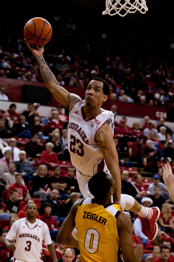 20 December 2011: Bo Spencer #23 of the Nebraska Cornhuskers with a lay up over the top of Trey Zeigler #0 of the Central Michigan Chippewas during the second half at the Devaney Sports Center in Lincoln, Nebraska. Nebraska defeated Central Michigan 72 to 69.