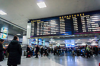 Travelers for Amtrak and NJ Transit in Penn Station in New York on Monday, January 23, 2017 wait by the departure board. Amtrak will be removing the departure board in Penn Station this evening replacing it with a digital board. Digital displays have already been placed around the station in an effort to alleviate congestion. Because of the N'orEaster train service on Amtrak has been severely disrupted with many trains cancelled. (© Richard B. Levine)