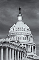 """Southeast view of the US Capitol Building in Washington DC showing the south wing, home of the House of Representatives, and the Capitol dome topped by the Statue of Freedom.  The South wing includes a pediment by Paul Wayland Bartlett entitled """"Apotheosis of Democracy""""."""