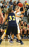 SIOUX FALLS, SD - JANUARY 2:  Teagan Molden #30 from the University of Sioux Falls spots up for a jumper over Nicole Kerkhoff #32 from Augustana in the first half of their game Friday night at the Stewart Center. (Photo by Dave Eggen/Inertia)