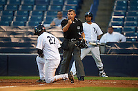 Umpire Jonathan Parra calls Miguel Andujar (27) out at home during a game between the Bradenton Marauders and Tampa Yankees on April 11, 2016 at George M. Steinbrenner Field in Tampa, Florida.  Tampa defeated Bradenton 5-2.  (Mike Janes/Four Seam Images)