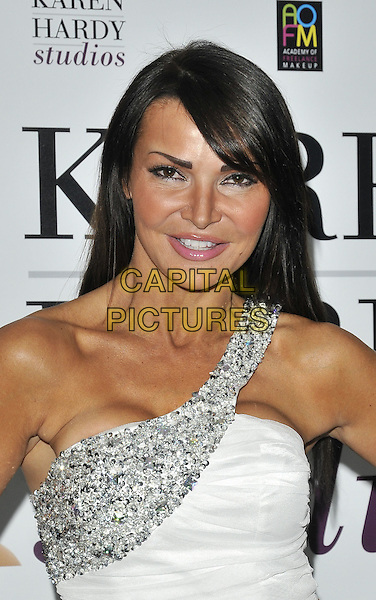 LIZZIE CUNDY .At the Chelsea Summer Gala, Wyndham Grand Hotel, Chelsea Harbour, London, England, 23rd July 2010..portrait headshot white one shoulder  silver beaded cleavage .CAP/CAN.©Can Nguyen/Capital Pictures.