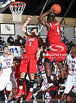 Lamar Cardinals guard Devon Lamb (4) grabs a rebound in the game between the Lamar University Cardinals and the University of Texas-Arlington Mavericks held at the University of Texas in Arlington's Texas Hall in Arlington, Texas. Lamar defeats UTA 76 to 72