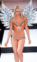Miami Dolphins Cheerleader, Lauren J, walks runway at Miami Dolphins Cheerleaders 2013 Swimsuit Calendar Unveiling Fashion Show at LIV Nightclub in The Fontainebleau Miami Beach Hotel, Miami Beach, FL on August 26, 2012
