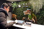 """March 15, 2017, Urayasu, Japan - A dinosaur robot greets a guest at a reception of the newly opened """"Henn na Hotel"""" (Strange hotel) near Tokyo Disney Resort in Urayasu, suburban Tokyo on Wednesday, March 15, 2017. Japan's travel agency H.I.S runs the Henn na Hotel which has only seven human employees while nine types 140 robot staffs work at the 100-room six-storey hotel.    (Photo by Yoshio Tsunoda/AFLO) LwX -ytd-"""