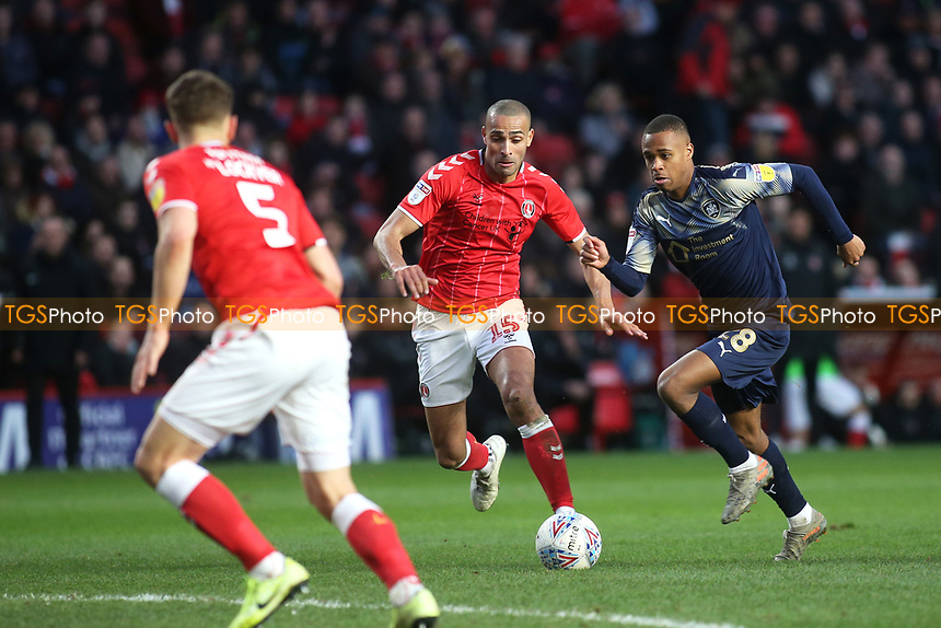 Elliot Simoes of Barnsley races upfield as Charlton's Darren Pratley looks on during Charlton Athletic vs Barnsley, Sky Bet EFL Championship Football at The Valley on 1st February 2020
