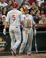 Phillies 3B Pedro Feliz greets Pat Burrell on Sunday May 25th at Minute Maid Park in Houston, Texas. Photo by Andrew Woolley / Four Seam Images..