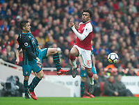 Arsenal's Alex Iwobi and Southampton's Dusan Tadic during the EPL - Premier League match between Arsenal and Southampton at the Emirates Stadium, London, England on 8 April 2018. Photo by Andrew Aleksiejczuk / PRiME Media Images.