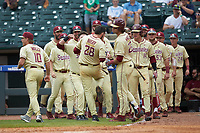 Dylan Busby (28) of the Florida State Seminoles is greeted by his teammates as he returns to the dugout after scoring a run during the game against the North Carolina Tar Heels in the 2017 ACC Baseball Championship Game at Louisville Slugger Field on May 28, 2017 in Louisville, Kentucky. The Seminoles defeated the Tar Heels 7-3. (Brian Westerholt/Four Seam Images)