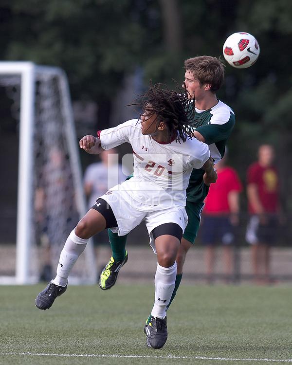 Boston College midfielder Tebs Maqubela (20) and George Mason University midfielder/defender Sean O'Reilly (15) battle for head ball. Boston College defeated George Mason University, 3-2, at Newton Soccer Field, August 26, 2011.