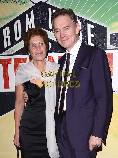guest &amp; Anthony Andrews<br /> 'From Here to Eternity' Press Night at the Shaftesbury Theatre, London, England.<br /> October 23rd 2013<br /> half length blue suit white wrap shawl black dress<br /> CAP/PP/MB<br /> &copy;Michael Ball/PP/Capital Pictures