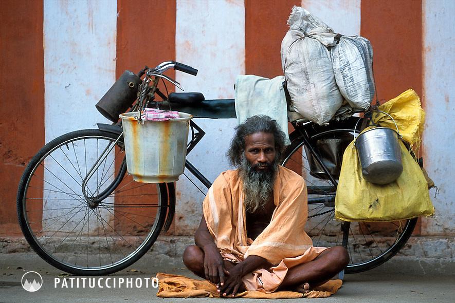 Sadhu with bike. India