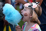 Palin Morgan, 7, enjoys cotton candy during the 14th annual National Night Out in Carson City, Nev., on Tuesday, Aug. 2, 2016. <br />