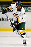 "5 January 2007: University of Vermont forward Peter Lenes from Shelburne, VT, in action against the University of New Hampshire Wildcats at Gutterson Fieldhouse in Burlington, Vermont. The UNH Wildcats defeated the UVM Catamounts 7-1 in front of a record setting 48th consecutive sellout at ""the Gut""...Mandatory Photo Credit: Ed Wolfstein Photo.<br />"