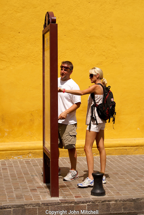Young tourists looking at a map in San Miguel de Allende, Mexico