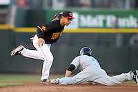 Rochester Red Wings second baseman Ray Chang #22 tags out Bryce Harper #34 on a stolen base attempt during a game against the Syracuse Cheifs at Frontier Field on April 25, 2012 in Rochester, New York.  Syracuse defeated Rochester 10-5.  (Mike Janes/Four Seam Images)