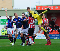Crewe Alexandra's Ben Garratt claims a high ball under pressure from Lincoln City's Michael Bostwick<br /> <br /> Photographer Chris Vaughan/CameraSport<br /> <br /> The EFL Sky Bet League Two - Lincoln City v Crewe Alexandra - Saturday 6th October 2018 - Sincil Bank - Lincoln<br /> <br /> World Copyright &copy; 2018 CameraSport. All rights reserved. 43 Linden Ave. Countesthorpe. Leicester. England. LE8 5PG - Tel: +44 (0) 116 277 4147 - admin@camerasport.com - www.camerasport.com