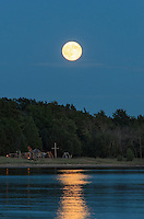 A bright full moon rising over the Lake Michigan shoreline. This was the second one of the month making it a blue moon.