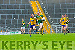 Kerry Mark Griffin is tracked by Roscommon's Conor Devanny during their NFKL Div 1 clash in Fitzgerald Stadium on Sunday