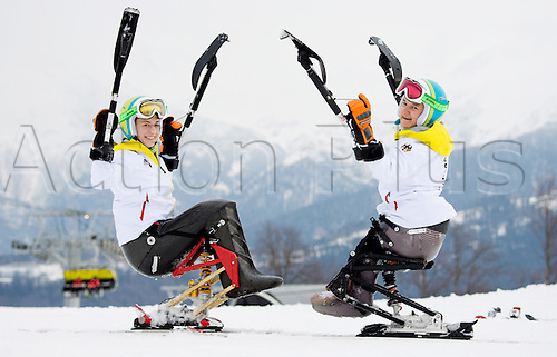 07.03.2014. Sochi, Russia.  Anna Schaffelhuber (L) and Anna-Lena Forster of Germany react during an unofficial training session in Rosa Khutor Alpine Center at the Sochi 2014 Paralympic Winter Games, Krasnaya Polyana, Russia, 07 March 2014.