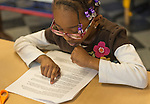 "Garden City, New York, U.S. January 20, 2014. JAEL CHARLTON, 6, of Freeport, reads King's 1963 ""I Have a Dream Speech"" at the program Dreaming with Dr. Martin Luther King, Jr. where children explored Dr. King's life and then created an artwork of peace, at the Long Island Children's Museum, to celebrate the American official federal holiday Birthday of Martin Luther King, Jr."