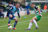 Michael Harriman of Wycombe Wanderers takes on Otis Khan of Yeovil Town during the Sky Bet League 2 match between Yeovil Town and Wycombe Wanderers at Huish Park, Yeovil, England on 8 October 2016. Photo by Mark  Hawkins / PRiME Media Images.
