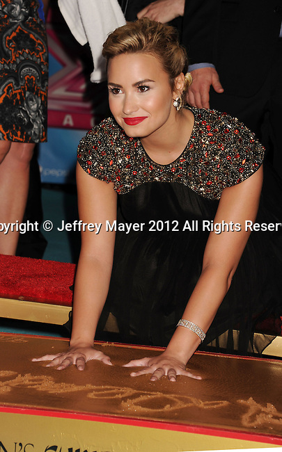 HOLLYWOOD, CA - SEPTEMBER 11: Demi Lovato arrives at the 'The X Factor' Season 2 Premiere Party at Grauman's Chinese Theatre on September 11, 2012 in Hollywood, California.