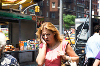 "A woman walks down 6th Avenue in New York City, talking on her cell phone on June 1st, 2011.  The World Health Organization (WHO) has listed mobile phone use in the same ""carcinogenic hazard"" category as lead, engine exhaust, and chloroform, making use of cell phones a possible cancer risk."