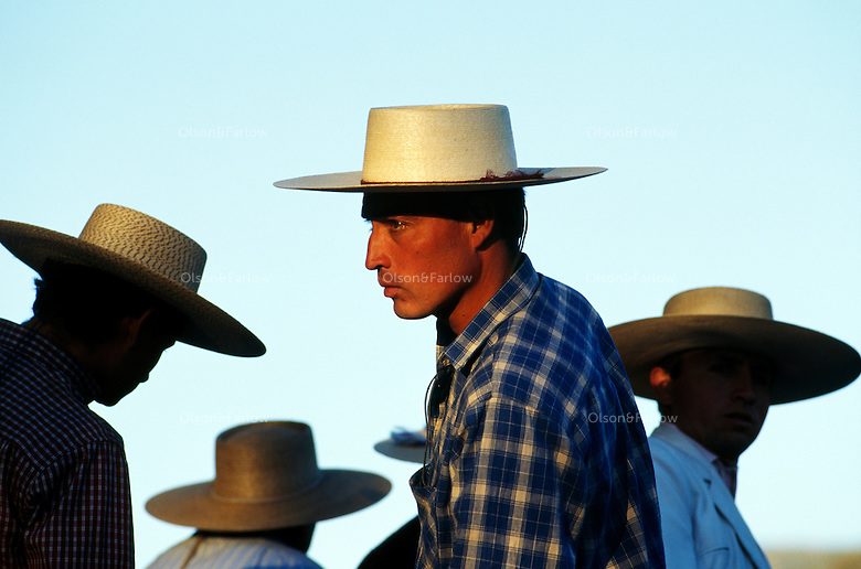 Hausos topped with Andalusian hats or flat-brimmed sombreros surround a ring northwest of Santiago to watch competition in a rodeo.