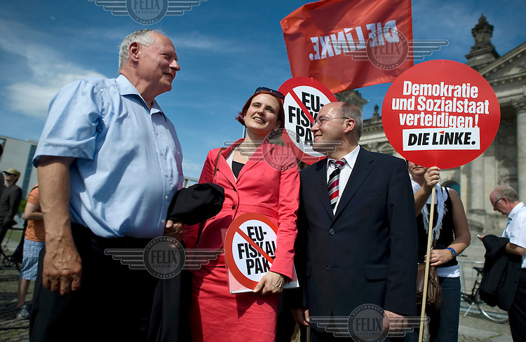 Oskar Lafontaine, Katja Kipping of the left wing party Die Linke and Gregor Gysi at a demonstration against the EU fiscal pact outside the Reichstag in Berlin. Bundestag members are set to vote on ratification of the fiscal pact and the ESM (European Stability Mechanism) inside the parliament.