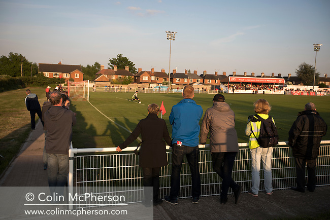 Spectators watching the first-half action at Yockings Park as Whitchurch Alport hosted Cammell Laird 1907 in the 2017-18 North West Counties Division One play-off final. Alport were formed in 1946 and were named after Alport Farm, Whitchurch, which had been the home of a local footballer Coley Maddocks who had been killed in action in the war. The home team won the match 2-1 watched by a crowd of 773, a club record attendance.