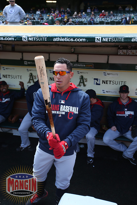 OAKLAND, CA - APRIL 2:  Asdrubal Cabrera #13 of the Cleveland Indians gets ready in the dugout before the game against the Oakland Athletics at O.co Coliseum on Wednesday, April 2, 2014 in Oakland, California. Photo by Brad Mangin