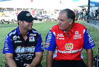 Sept. 23, 2012; Ennis, TX, USA: NHRA funny car driver Matt Hagan (left) talks with Johnny Gray during the Fall Nationals at the Texas Motorplex. Mandatory Credit: Mark J. Rebilas-