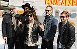 LOS ANGELES, CA - APRIL 12:  (L-R) Recording artists Mike Retondo, Tim Lopez, De'Mar Hamilton, Tom Higgenson and Dave Tirio of music group Plain White T's arrive at the 2015 MTV Movie Awards at Nokia Theatre L.A. Live on April 12, 2015 in Los Angeles, California.