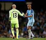 Wilfredo Caballero of Manchester City offers Vincent Kompany of Manchester City a drink during the English Premier League match at the Etihad Stadium, Manchester. Picture date: May 16th 2017. Pic credit should read: Simon Bellis/Sportimage