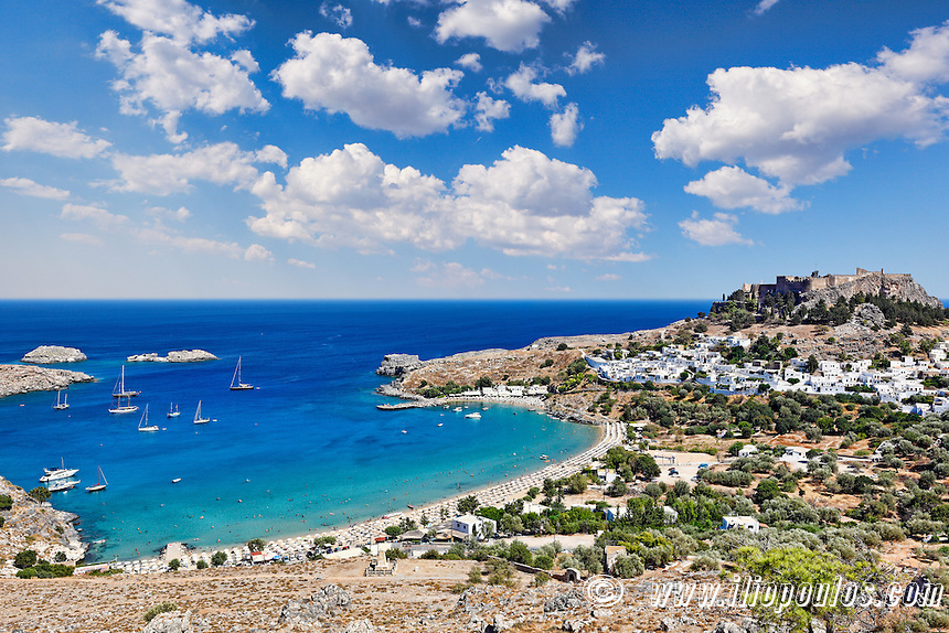 The village of Lindos with a beautiful bay, medieval castle and pictursque houses on a hill is the star of Rhodes, Greece.