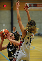 Action from the 2017 AA Girls' Secondary Schools Basketball Premiership National Championship match between New Plymouth Girls' High School (white) and Melville High School (navy) at the B&M Centre in Palmerston North, New Zealand on Wednesday, 4 October 2017. Photo: Dave Lintott / lintottphoto.co.nz